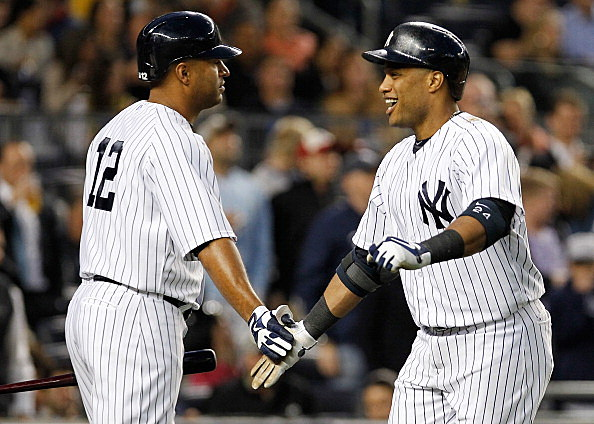 Vernon Wells and Robinson Cano