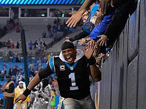 Cam Newton celebrates the win (Grant Halverson).